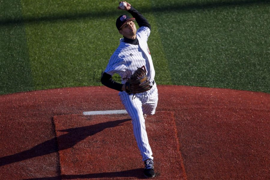 Redshirt+Junior+Ryan+Thurston+%2820%29+pitches+the+ball+during+the+5-4+win+against+Ohio+University+on+Friday%2C+March+3+at+Nick+Denes+Field.