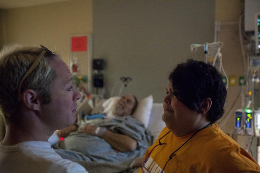 Lee Cox visits his friends, Charita Moyers and her husband, Willie, to offer support after Willie suffered a brain injury and was hospitalized on March 24, 2017. Charita has not left his side since.