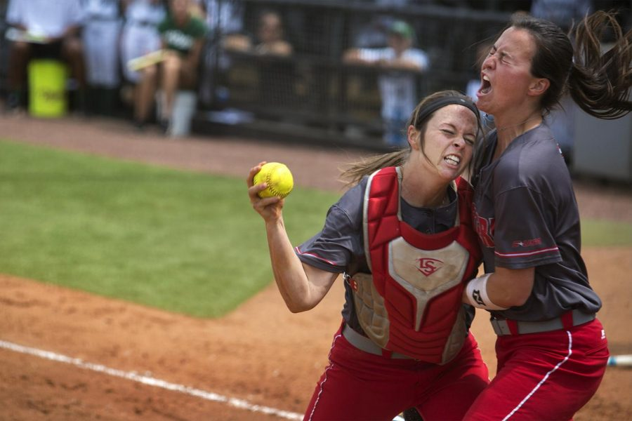 WKU seniors Taylor Proctor, catcher, and Kathryn Downing, pitcher, celebrate after Proctor tagging a runner out while sliding to home plate during the game against Charlotte on Saturday April 15, 2017 At the Softball Complex.Brook Joyner/HERALD