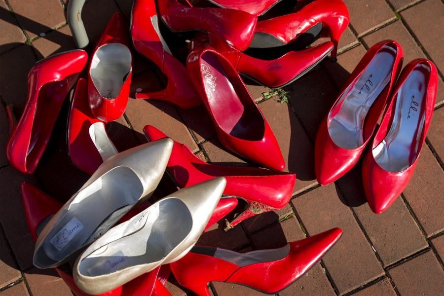 After the conclusion of the Walk a Mile in Her Shoes event on Tuesday, participants return their high heel shoes to the pile and tables at Centennial Mall. The event raised a total of $2,500 for Hope Harbor.