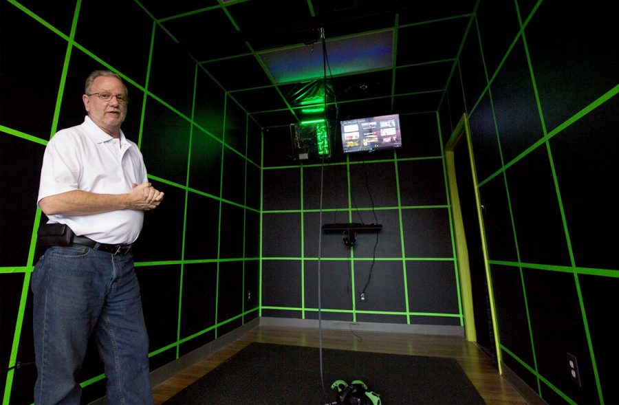 Duane Tyler, also known as Pops, poses for a portrait in the recently opened virtual video arcade, The Holodeck VR on April 11th.Tyler, fellow business parter to Joey Stratton and Nick Lapierre, is eager for what the arcade will do for Bowling Green.