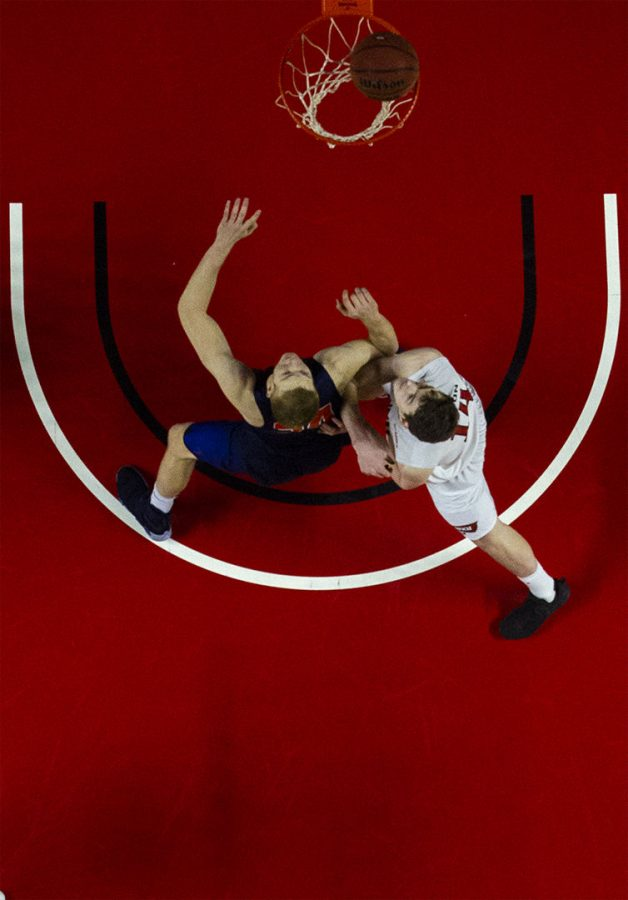 WKU forward Ben Lawson (14) and University of Texas at El Paso center Kelvin Jones (54) fight for rebounding position during the Hilltoppers 65-62 win over UTEP Thursday Jan. 26, in E.A. Diddle Arena.