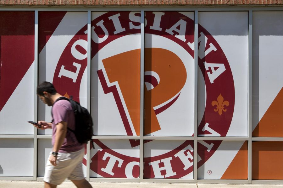 A student walks past Popeye's before the restaurant on Wednesday May 3, 2017. The restaurant will be closing down it's only Bowling green location at the end of the semester. Brook Joyner/HERALD