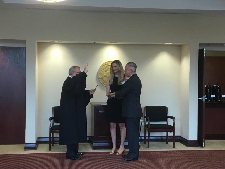 Timothy C. Caboni is sworn in as WKU's 10th president by Chief Justice John D. Minton alongside wife and director ofprincipal gifts and special initiatives,Kacy Caboni during a quarterly Board of Regents meeting. Rebekah Alvey/WKU Herald