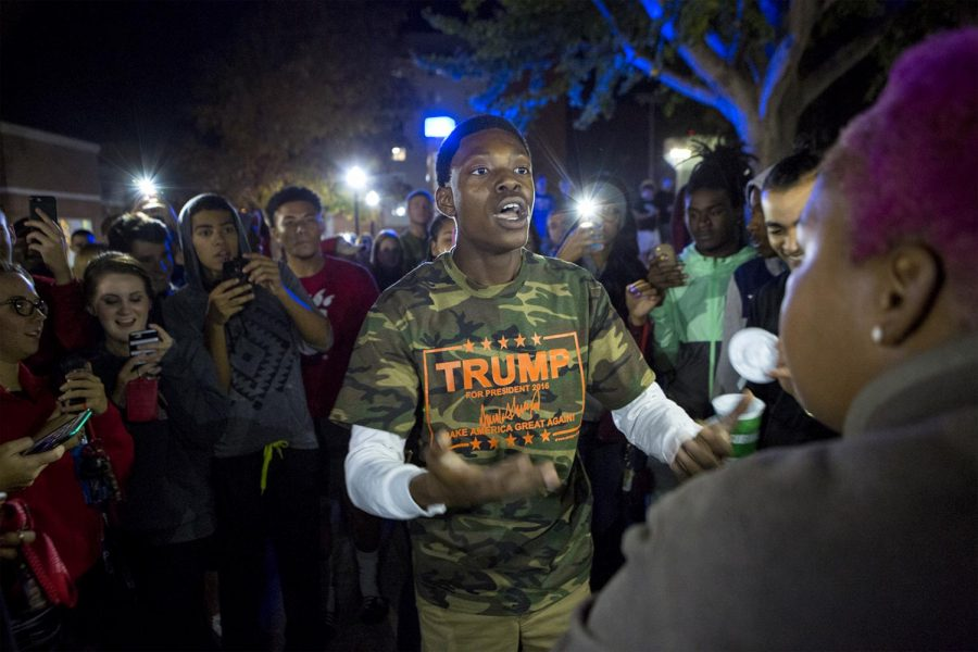 Nate Washington, a former political science major and president of the WKU chapter of College Republicans, argues with KeKe White, 18 during an anti-Trump protest on Nov. 9, 2016, outside of Pearce-Ford Tower. A recording of Washington using derogatory terms while serving as intern to U.S. Sen. Tom Cotton, R-Ark., was posted in an article by Mediaite. Kelsea Hobbs/HERALD