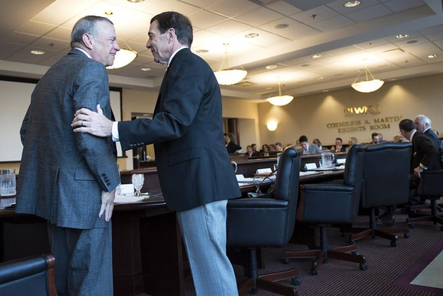 J. David Porter and John W. Ridley greet each other before the Board of Regents meeting on March 24, 2017.