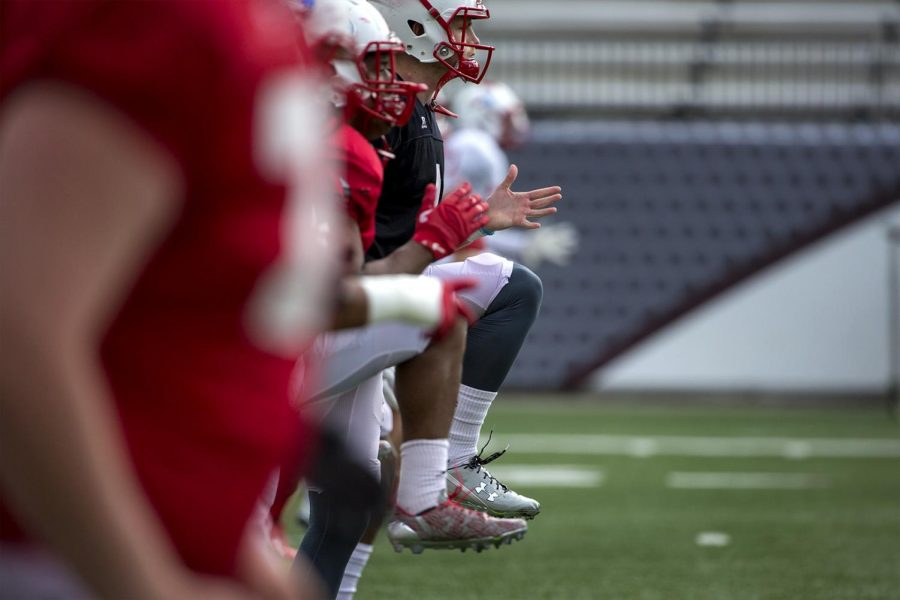 WKU football players do high-knee drills before going through their plays during practice on Tuesday at L.T. Smith Stadium.