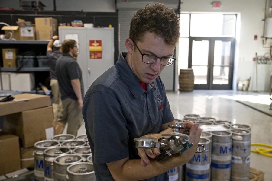 Brewery supervisor Josh Newell gets ready to keg beer on Wednesday Aug. 23, 2017 at the WKU research center.