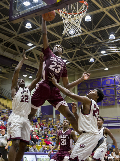 Chalmette High School Senior Mitchell Robinson (23) attempts to score a basket in a game against Ballard High School on Sat. Feb. 11, 2017 at Bowling Green High School. The 7 foot 5-star recruit signed to WKU on Nov. 15, 2016.