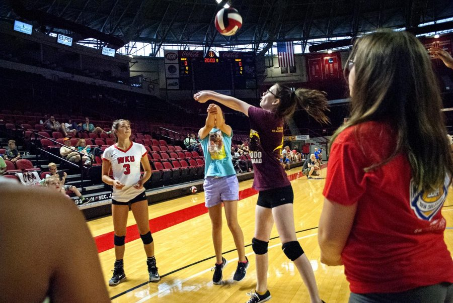 Emma+Kowalkowski+Sophomore+from%C2%A0Lake+Orion%2C+Michigan%2C+assists+volleyball+players+at+an+Volleyball+Clinic+hosted+by+the+WKU+Volleyball+team+in+Diddle+Arena+on+Aug.+19.+Kowalkowski+said+she+likes+%22seeing+their+progress+...+and+making+them+fall+in+love+with+the+sport+at+a+young+age.%22