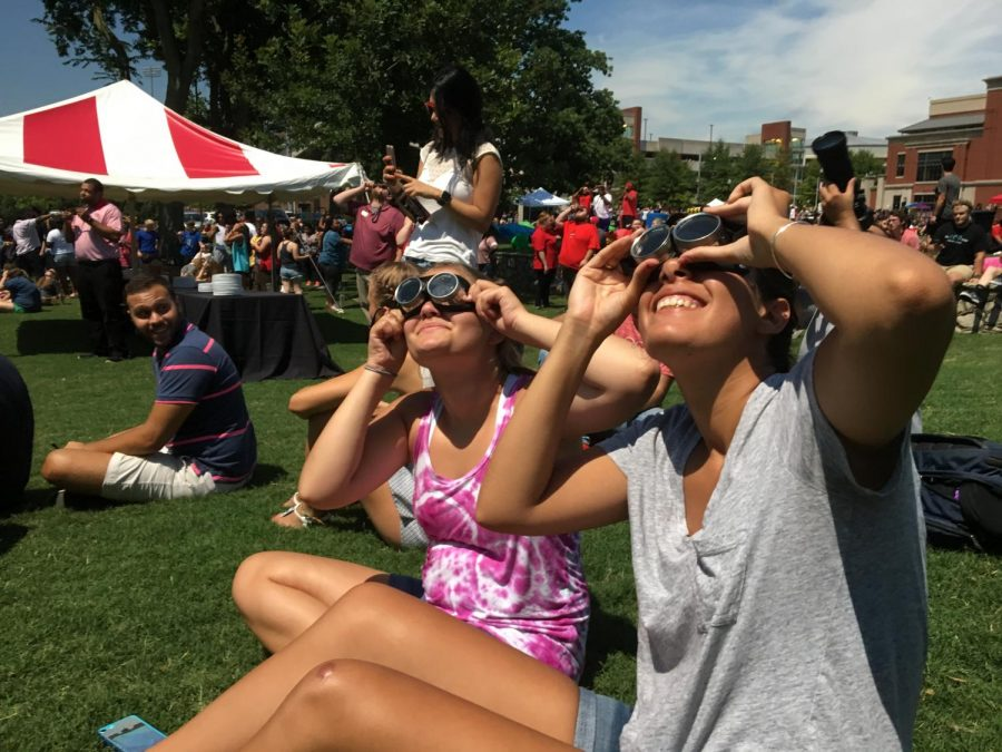 Centre College sophomore Zahra Ortiz (right) watches the eclipse using welding goggles ordered by her dad, an ophthalmologist, with her roommate, Reagan Lynn. They originally planned on traveling to Hopkinsville for the eclipse but came to WKU to avoid traffic.