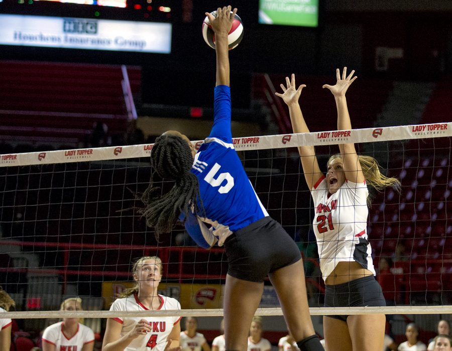 Junior Taylor Dellinger (21) goes up to block Tennessee State Rachel Henderson (5), during WKU's game on Tuesday night in Diddle Arena. WKU womens volleyball won their first home game against Tennessee State on Tuesday in Diddle Arena.