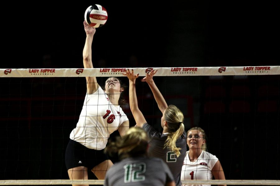 Senior outside hitter Sydney Engle (16) goes up for a hit in WKU's match against University of Alabama-Birmingham on Friday, Oct. 14, 2016 at Diddle Arena. Matt Lunsford/HERALD