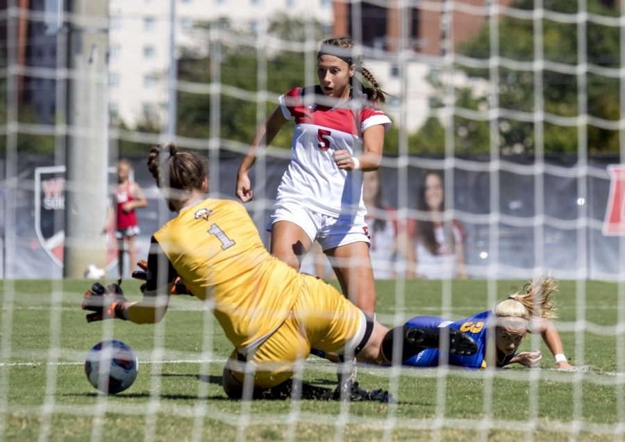 Sophomore forward Chandler Backes (5) takes a shot on goal against Morehead State's goalie Eva Yr Helgadottir (1) during WKU's 2-0 victory Sunday, Sept. 11, 2016, at the WKU Soccer Complex. Evan Boggs/HERALD