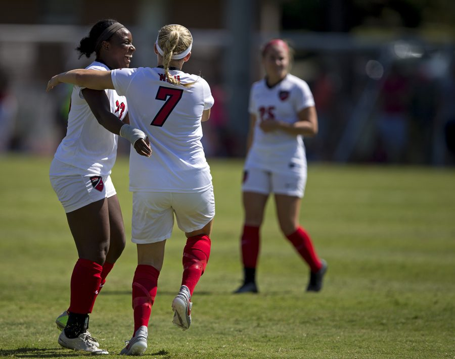 Senior Forward Bria Mosley (23) goes to hug Freshman forward Ashley Leonard (7) after she scored a goal in over time to win WKU's game verses UT Martin on Sunday August 27 at the WKU Soccer Complex.