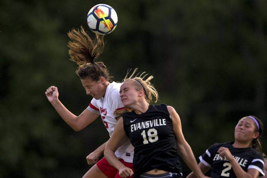 WKU forward Chandler Backes (5) heads the ball as she is defended by Evansville midfielder Maggie Leazer (18) during the Lady Topper's game against University of Evansville on Sunday, Sept. 3, 2017 at WKU Soccer Complex.