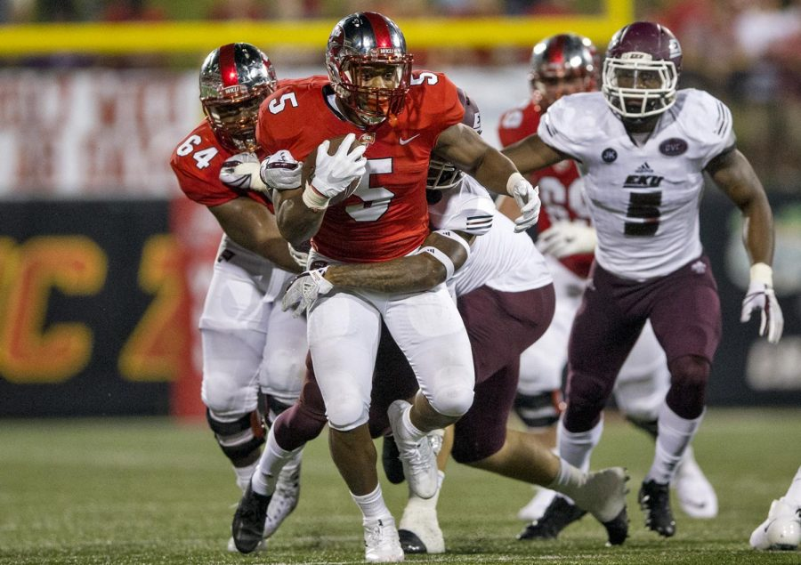 Eastern Kentucky University defensive back JordanWhitfield (10) garbs Western Kentucky University running back Marquez Trigg (5) during the second half of the WKU - EKU football game on Saturday, Sept. 2, 2017 at L.T. Smith Stadium. WKU defeated EKU 31-17.