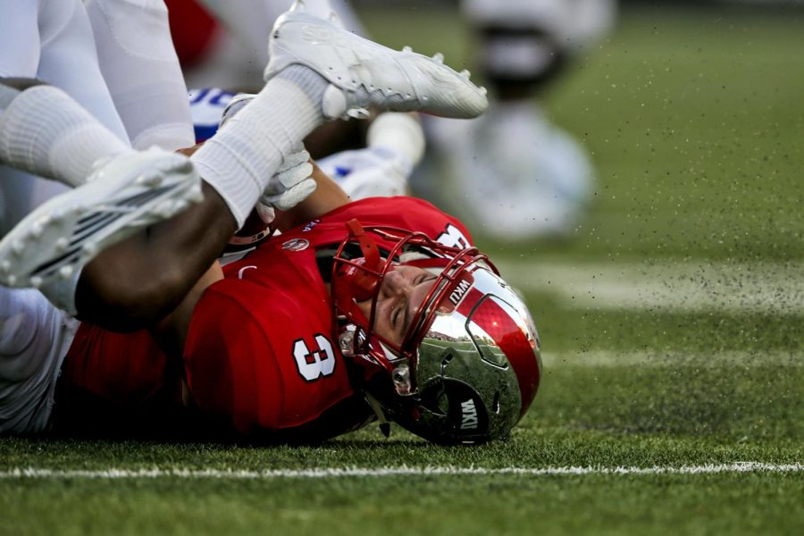 Western Kentucky University running back Quinton Baker (3) is tackled to the ground during the Hilltoppers' 22-23 loss to Louisiana Tech University on Saturday September 16, 2017 at L.T. Smith Stadium.