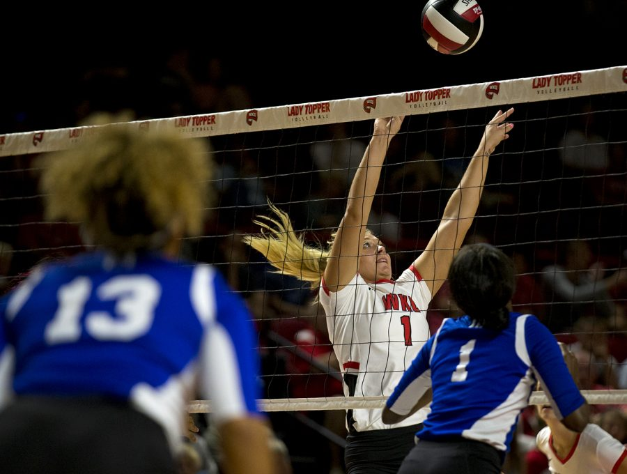 Senior Jessica Lucas sets the ball to a teammate during a game against Tennessee State Tuesday, Aug. 29, 2017 in E.A. Diddle Arena. WKU won 3-0.