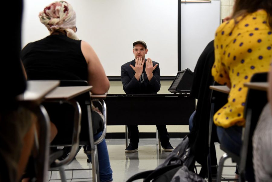 Bas Böttcher, a poet of Berlin, Germany, speaks with a group of students about the essence of German poetry writing on Sept. 27.