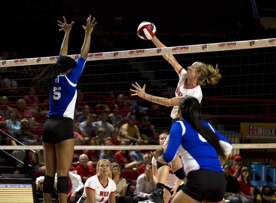 Junior middle hitter Rachel Anderson of Sturgis, Mich. spikes the ball over the net against Tennessee State Tuesday, August 29, 2017 in Diddle Arena. WKU beat TSU with a final score of 3-0.
