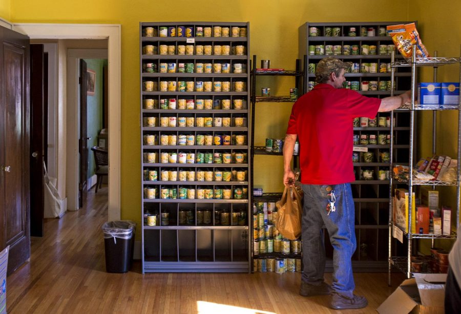 Johnny Brown collects food from the food pantry at WKU's Office of Sustainability Friday, Sept. 15. After the high demand for the original food pantry, a new one is being started on South Campus.