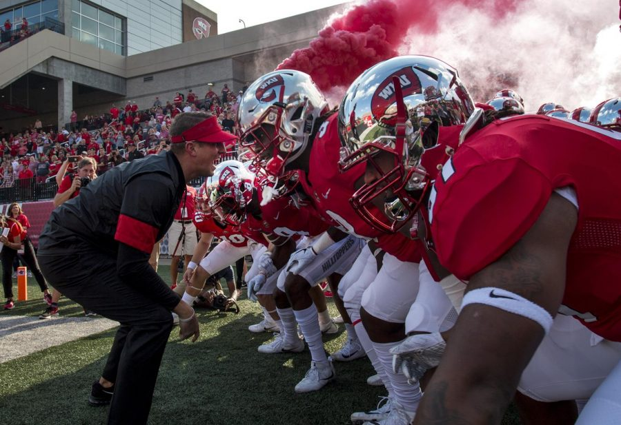 WKU Head Coach Mike Stanford gets his team energized his team before taking the field at WKU's Home Coming Football Game on Saturday, Oct. 14 in Houchens-Smith Stadium.