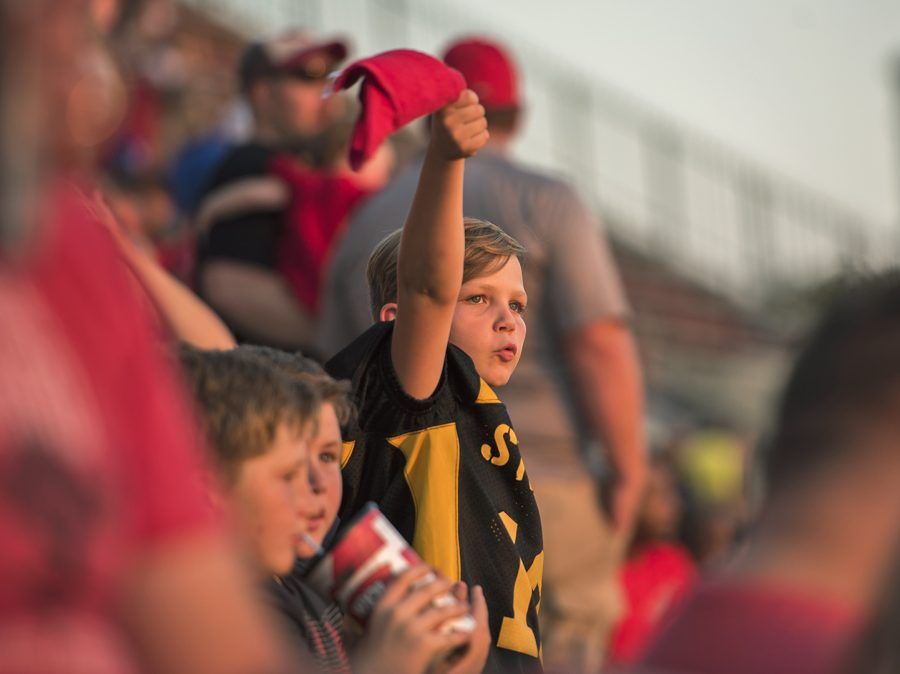 Ayden Horn, 10, cheers on the Hilltoppers at the homecoming game on Saturday in the Houchens Industries–L. T. Smith Stadium. Horn attended the game with his teammates from the Steelers, an elementary school football team, named after the NFL football team, at Clarkson Elementary in Grayson County.
