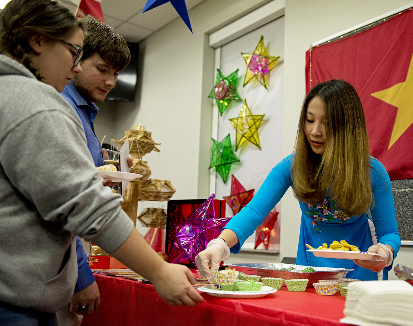 Nga Nguyen, an Alumni of Western Kentucky University, helps hand out traditional Vietnamese snacks at the mid-autumn festival on Friday, October 20. The event was sponsored by the Vietnamese, Chinese, and Korean student organizations on WKU's campus. The festival, also referred to as the moon festival, gave students and community members the opportunity to experience and learn about three different Asian cultures.