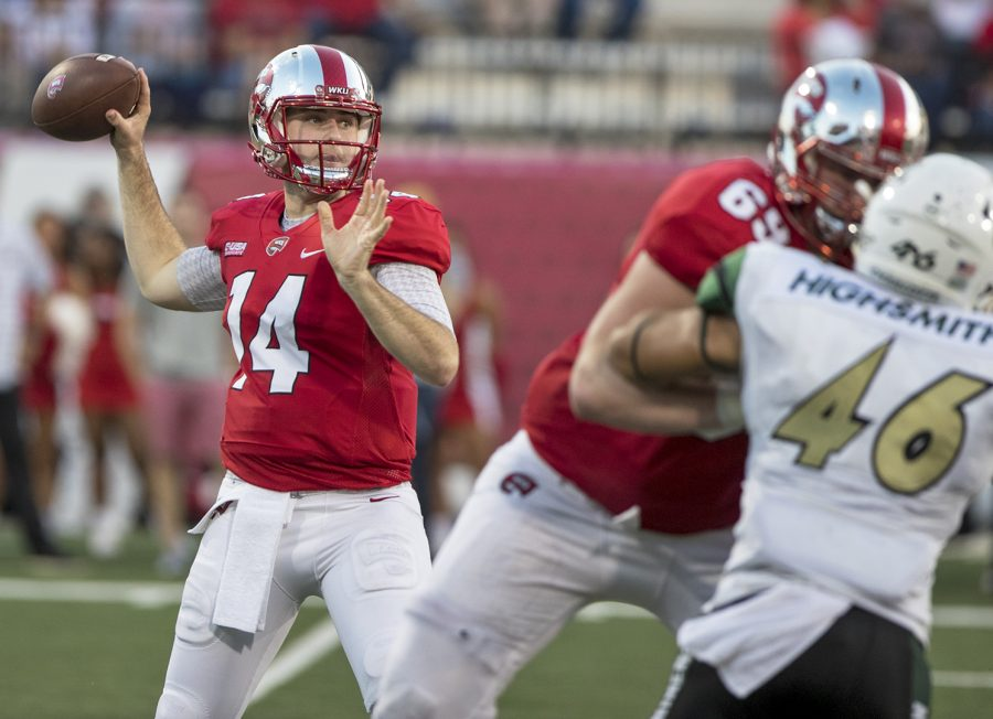 WKU+quarterback+Mike+White+%2814%29+spots+an+open+teammate+for+a+pass+at+the+WKU+Homecoming+football+game+on+Saturday+at+Houchens-Smith+Stadium.