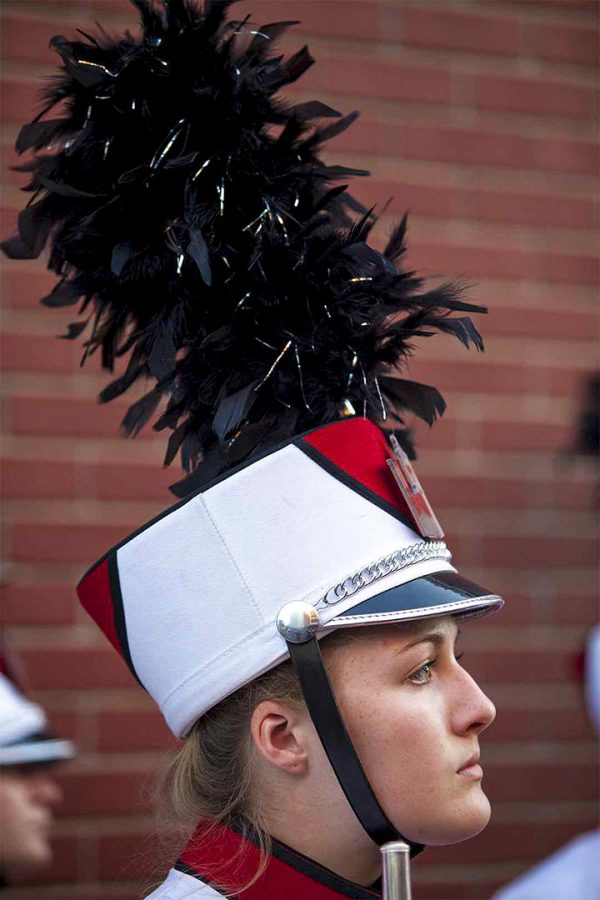 Hopkinsville freshman Emily Jeffords listens to the band director during the Big Red Marching Band's practice before the game on Thursday outside Smith Stadium. Shaban Athuman/HERALD