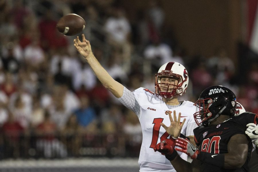 WKU quarterback Mike White (14) throws a pass during WKU's game vs Ball State on September 23, 2017 in L.T. Smith Stadium.