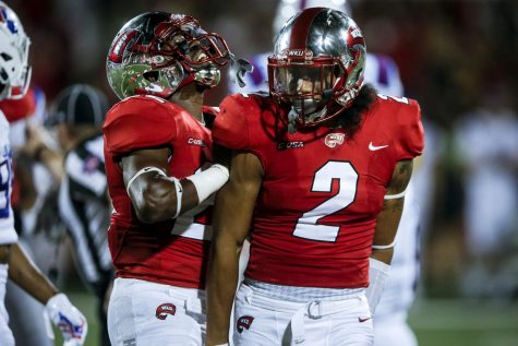 WKU defensive Devon Key celebrates with his teammates during the Hilltoppers