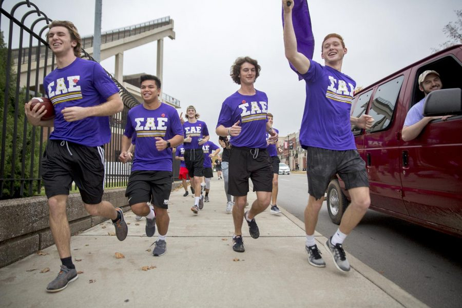 Members of Sigma Alpha Epsilon run down Avenue of Champions on Friday Nov. 6 to kick off their run from Bowling Green to Nashville. A group of more than 20 men from the fraternity volunteered to participate in the run in an effort to raise money for children in need of bikes.