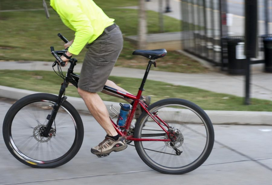 A+man+bikes+across+WKU%E2%80%99s+campus+on+Tuesday%2C+Oct.+17.+WKU%E2%80%99s+Parking+and+Transportation+Services+is+considering+adding+a+bike+share+program+to+campus.