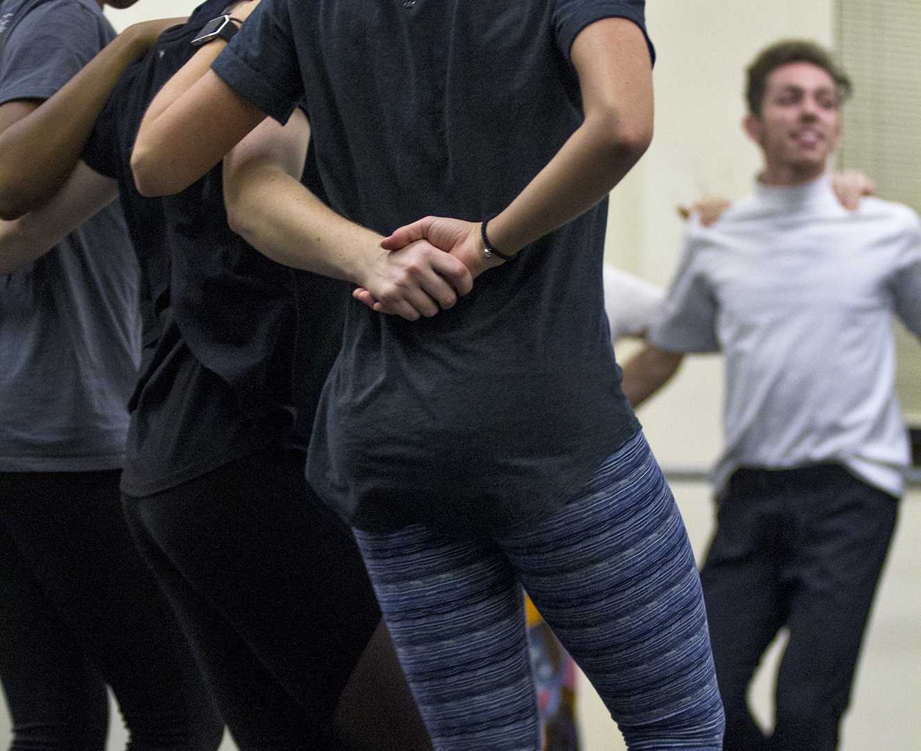 Trevor Edwards, a senior WKU dance major (right) dances in sync to a traditional Bosnian dance for the International year of Bosnia and Herzegovina class put on by the National Dance Education Organization WKU Student Chapter.