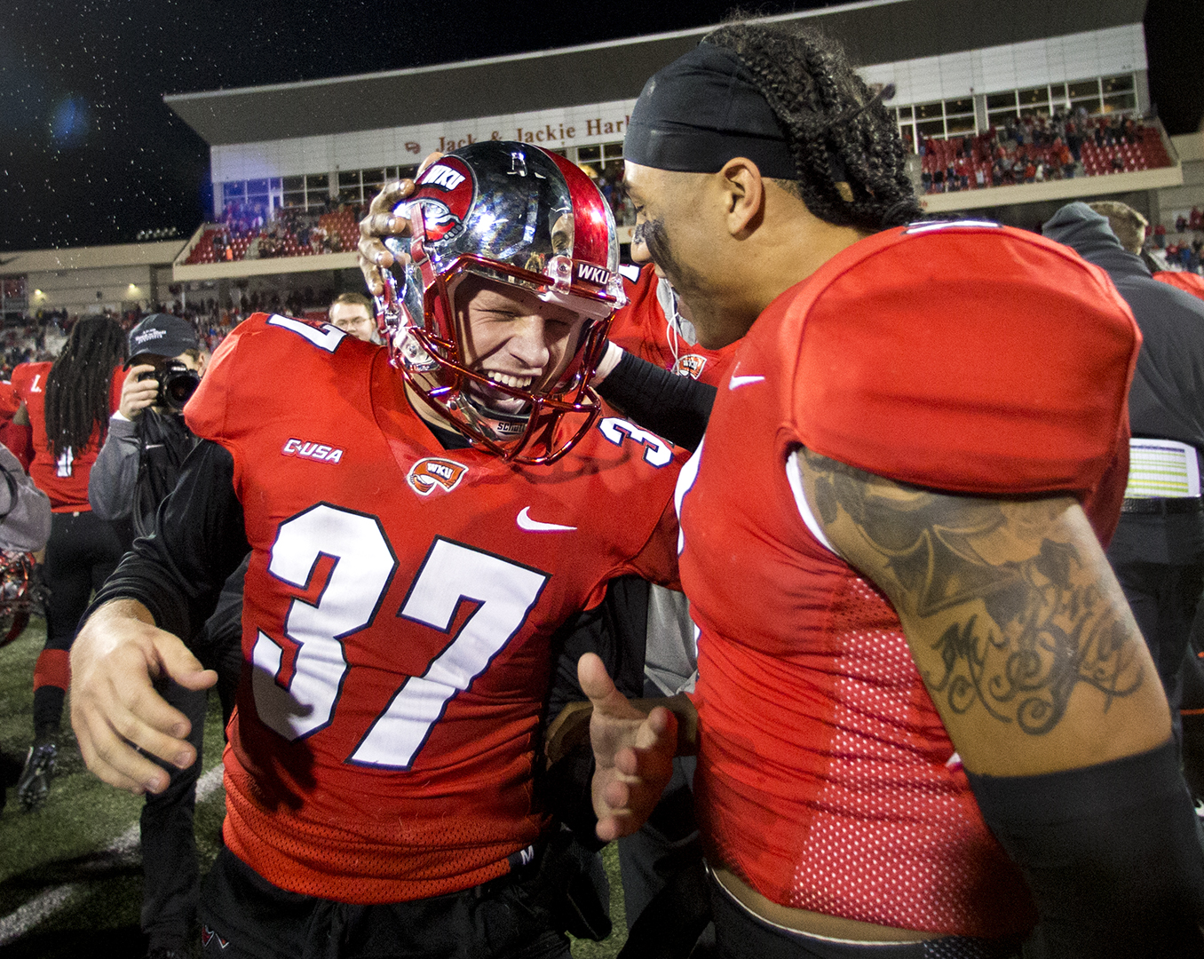 WKU kicker Ryan Nuss (37) is congratulated by Jacquez Sloan (2) after kicking a field-goal in triple over time to win their game vs. MTSU 41-38 in L.T. Smith stadium.