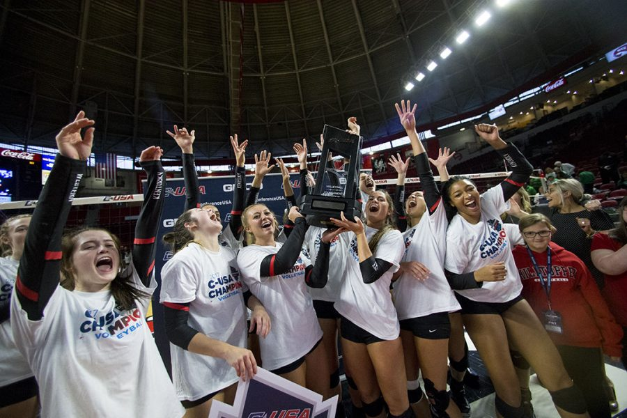 WKU's Lady Topper Volleyball team hold up the trophy as they celebrate their win of first place in the Conference USA tournament.
