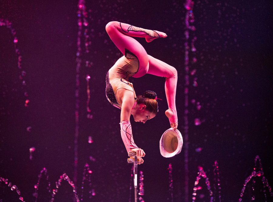 Sandy Giannuzzi performs a contortionist act at Cirque Italia's Water Circus on Sunday. This was the first time the water circus has come to Bowling Green.