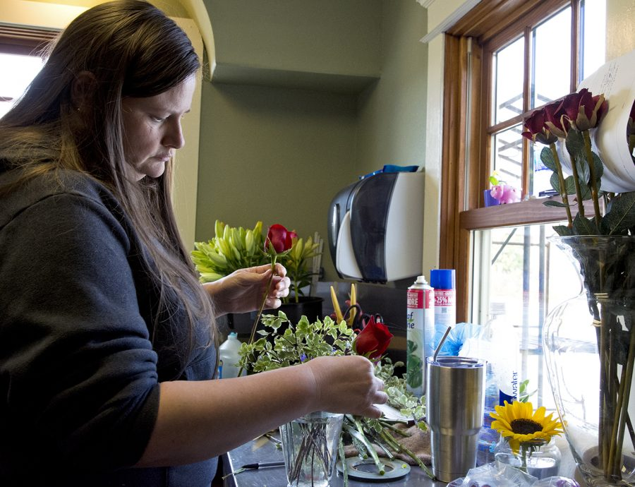 Campbellsville senior, Amy Murphy makes a floral arrangement for a client at the WKU Floral House on Tuesday, October 31.