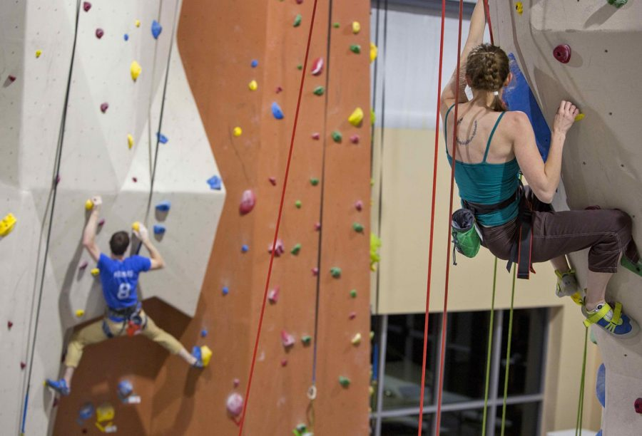 Laura+DeLancey+of+Oregon+climbs+her+way+to+the+top+while+Yvonne+Petkus+of+New+Jersey+provides+rope+support.+The+two+work+in+different+departments+at+WKU+and+have+been+coming+to+Vertical+Excape+for+about+two+to+three+times+a+week.+%22It%27s+both+physical+and+mental+exercise%2C%22+DeLancey+said.