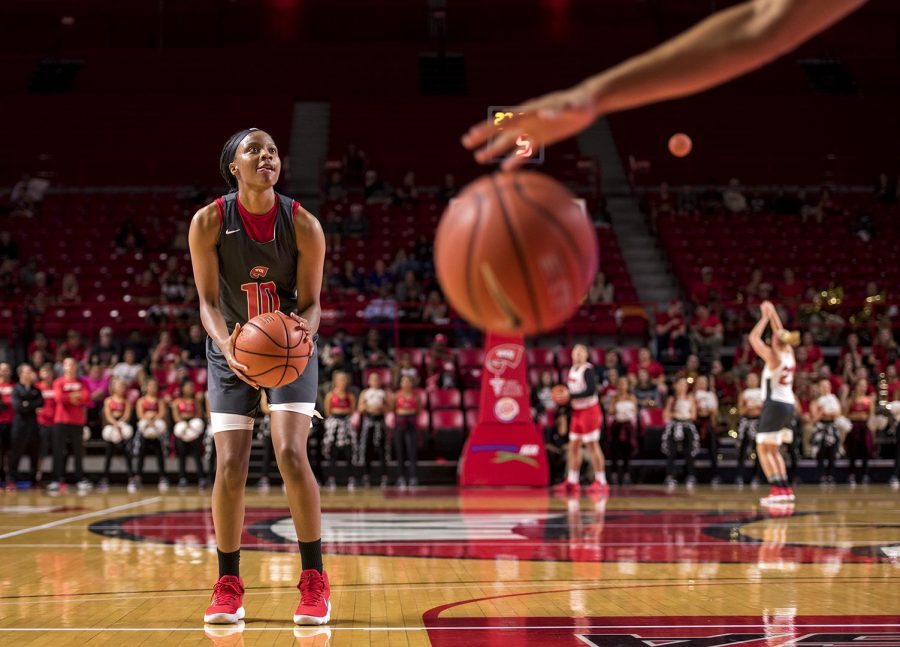 Senior+Tashia+Brown+of+Lake+Park%2C+Ga.+competes+with+a+member+of+the+WKU+men%E2%80%99s+basketball+team+during+Hilltopper+Hysteria%2C+on+Friday%2C+Oct.+13.