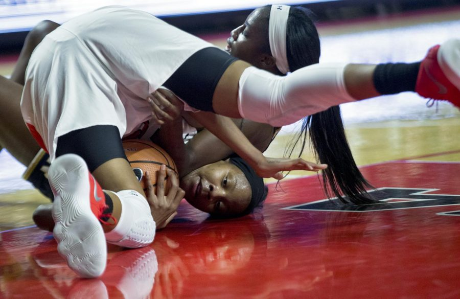 WKU+senior+forward+Tashia+Brown+%2810%29+wrestles+for+the+ball+with+an+opposing+player+during+their+game+against+Notre+Dame+on+Tuesday+Nov+14%2C+2017+in+EA+Diddle+Arena.+The+Lady+Toppers+lost+78-65.