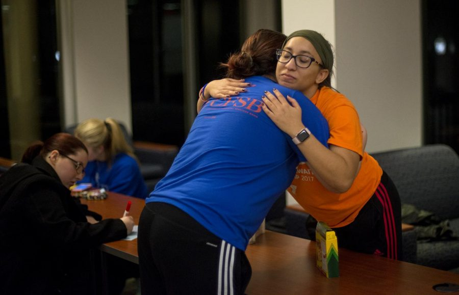 Rodes Harlin Hall R.A. Jordan Saunders (right), comforts Kenzlea Kaufman (left) after learning that her cousin, Bailey, was killed in the Marshall County High School shooting last week. Kaufman explained Bailey passed away on the scene of the shooting after pushing a friend out of the way of gunfire.
