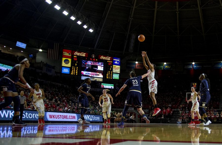 WKU+junior+Kayla+Smith+%2832%29+shoots+a+deep+three+pointer+during+WKUs+game+vs.+Notre+Dame+on+Nov+14%2C+2017+in+E.A.+Diddle+Arena.+The+Lady+Toppers+lost+78-65.