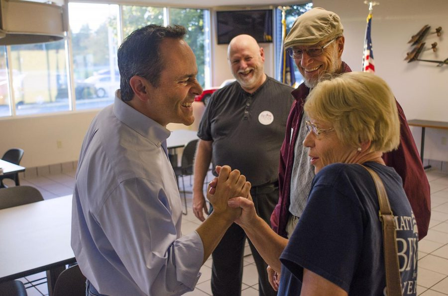Gubernatorial candidate Matt Bevin (R-Ky) talks with supporters after a small rally in the Bowling Green-Warren County Regional Airport. Despite lagging in the polls, Bevin said that he remained confident in his party's ability to win key offices in the states government. Andrew Livesay/HERALD