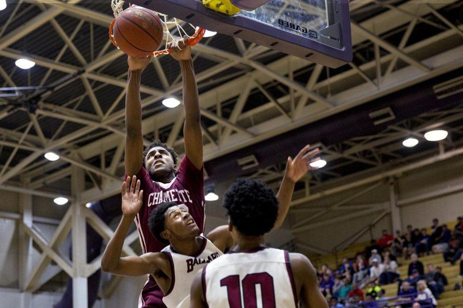 WKU freshman center Mitchell Robinson (23) scores a basket for Chalmette High School in a game against Ballard High School on Sat. Feb. 11, 2017 at Bowling Green High School.