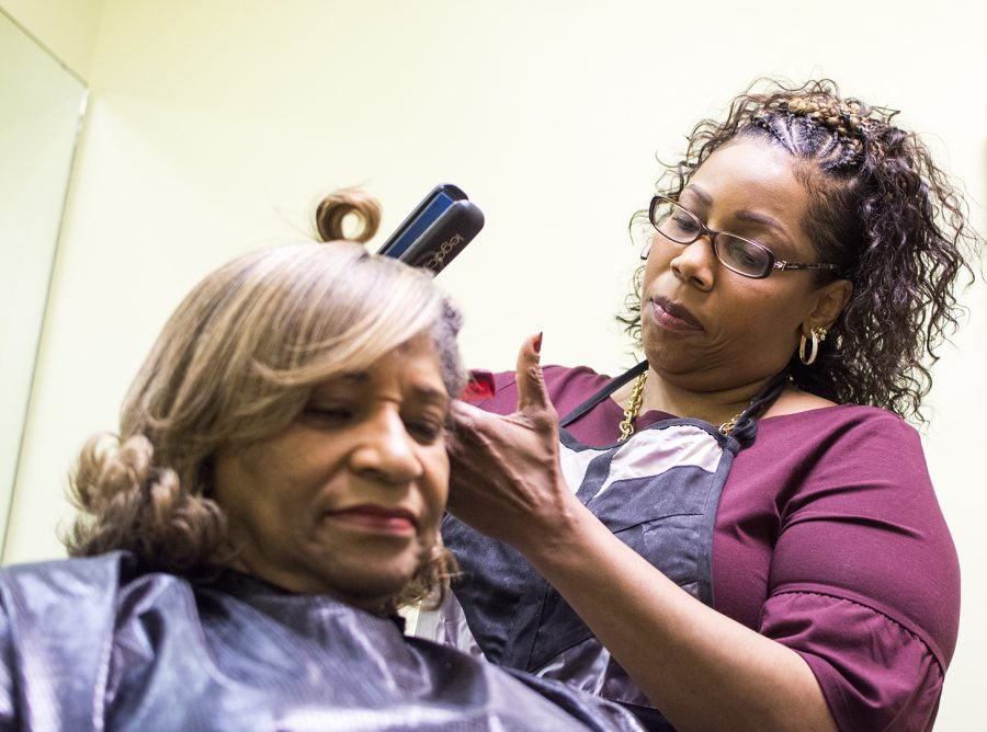 Tammra Turner styles hair on Feb. 21 in Bowling Green, Ky. After attending cosmetology school and working in a hair salon, Turner decided to open her own business. Turners daughter, Deidra Morrow, has also picked up hairstyling and is following in her mothers footsteps.