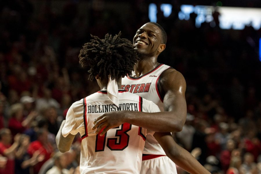 WKU forward Dwight Coleby embraces guard Taveion Hollingsworth in the dying seconds of the Hilltoppers' victory on Saturday, January 27. WKU beat Marshall 74-85 at E.A. Diddle Arena.