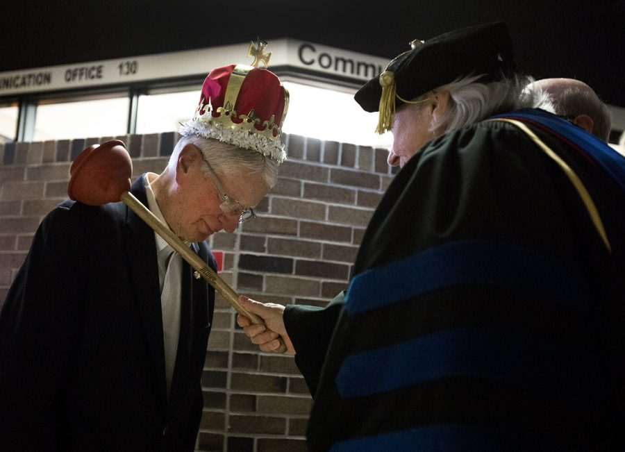 Communication+department+head+Helen+Sterk+knights+Dr.+Carl+Kell%2C+professor+emeritus%2C+during+his+chair+dedication+ceremony+Feb.+9+on+the+first+floor+of+the+fine+arts+center.